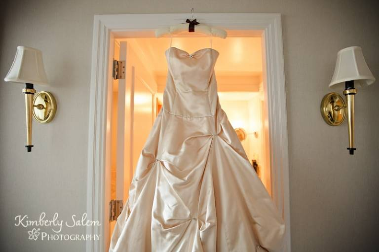Desiree's wedding dress hanging in the hotel room