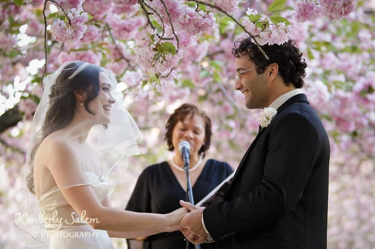 Desiree and Josh at the marriage ceremony among the cherry blossoms