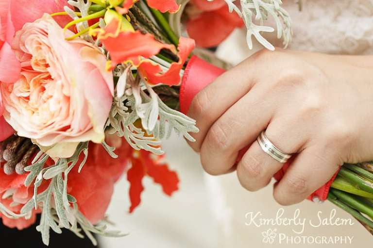bride holding her bouquet with focus on ring