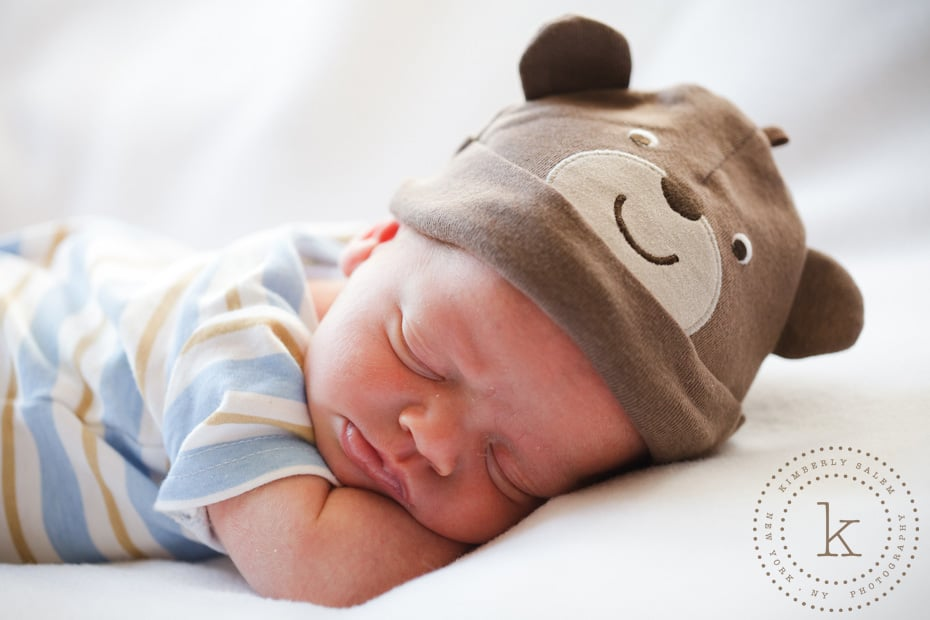 infant wearing bear hat