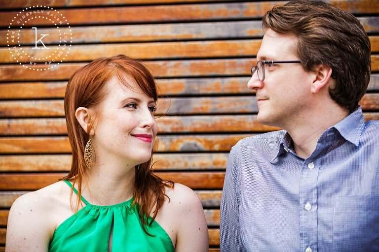 engaged couple - wood slat background