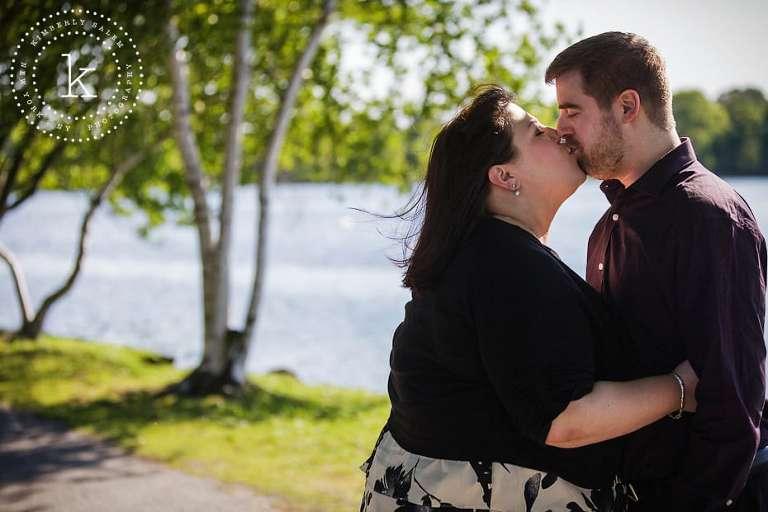 engaged couple kisssing - long island