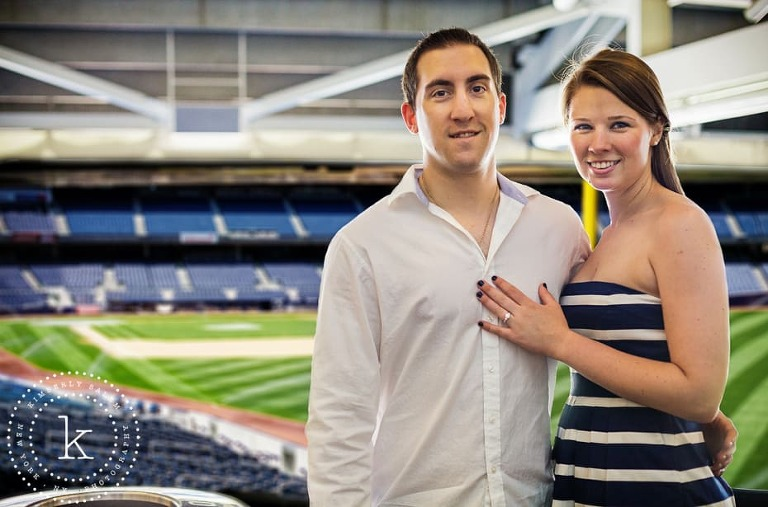 engaged couple at yankee stadium - with field in background
