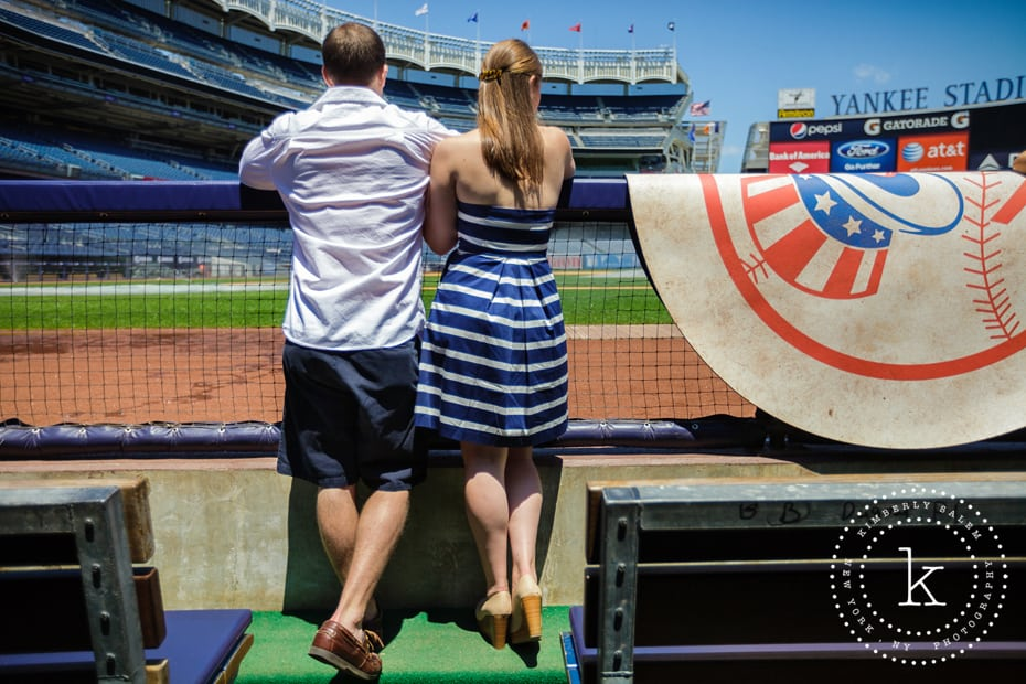 engaged couple in dugout at yankee stadium - looking onto field