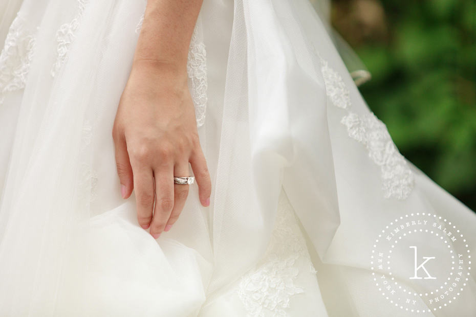 engagement ring detail with dress