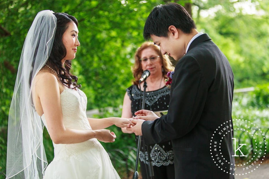 wedding ceremony at Linden Terrace in Fort Tryon Park, NYC - ring exchange