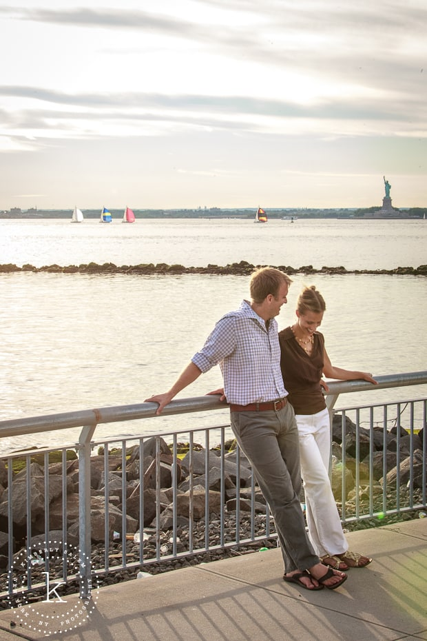 engaged couple in Brooklyn, NY - Red Hook - view of statue of liberty