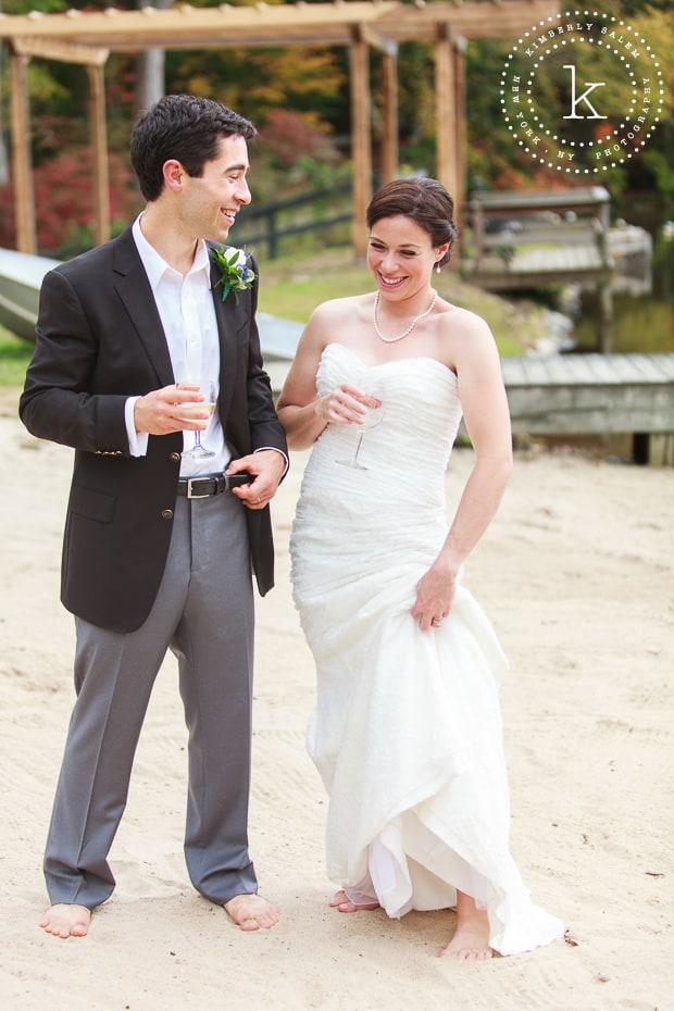 Barefoot bride and groom on the sand