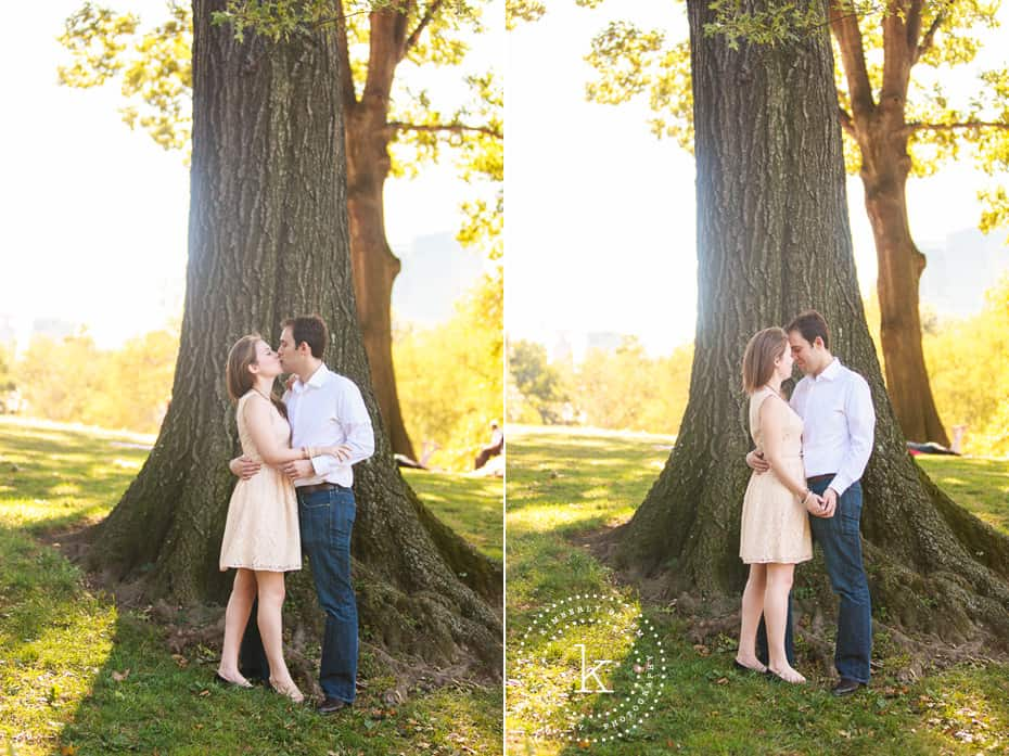 engaged couple in front of tree in central park