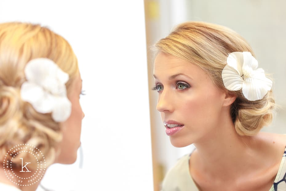 Bride checking her makeup