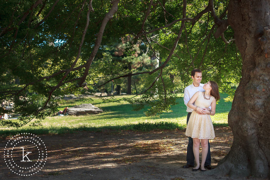 central park engagement photo under tree