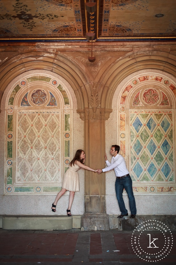 engaged couple at Bethesda Terrace lower passage in Central Park - holding hands