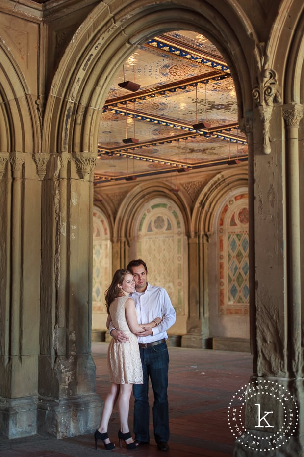 engaged couple at Bethesda Terrace lower passage in Central Park - underneath arch
