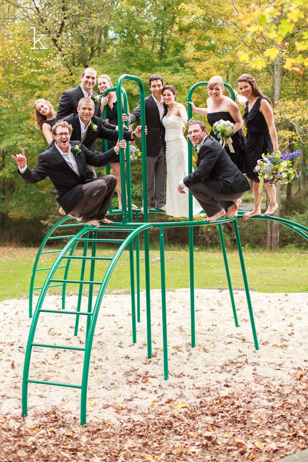 Bridal party on top of a jungle gym