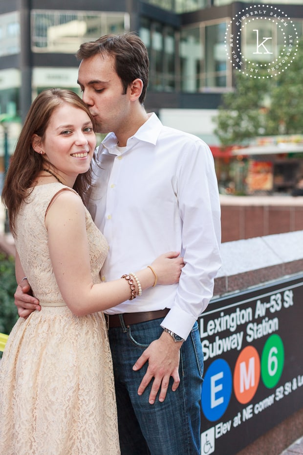 engaged couple by a NYC subway stop
