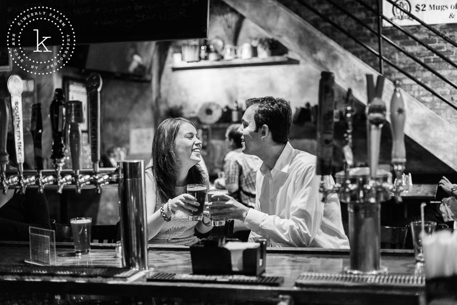 engaged couple with beers at the bar of The Stag's Head in NYC