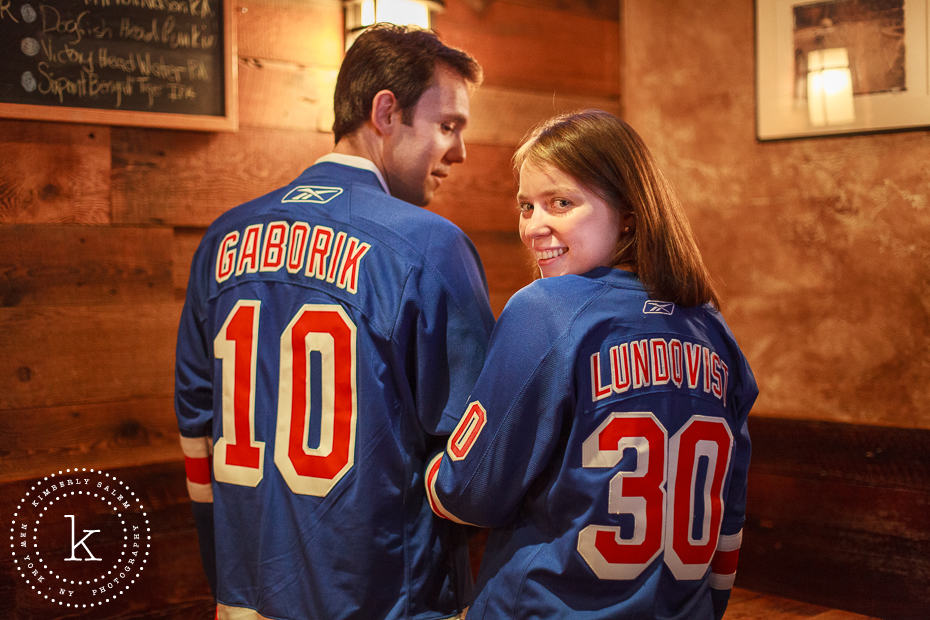 engaged couple wearing NY Rangers jerseys at The Stag's Head in NYC