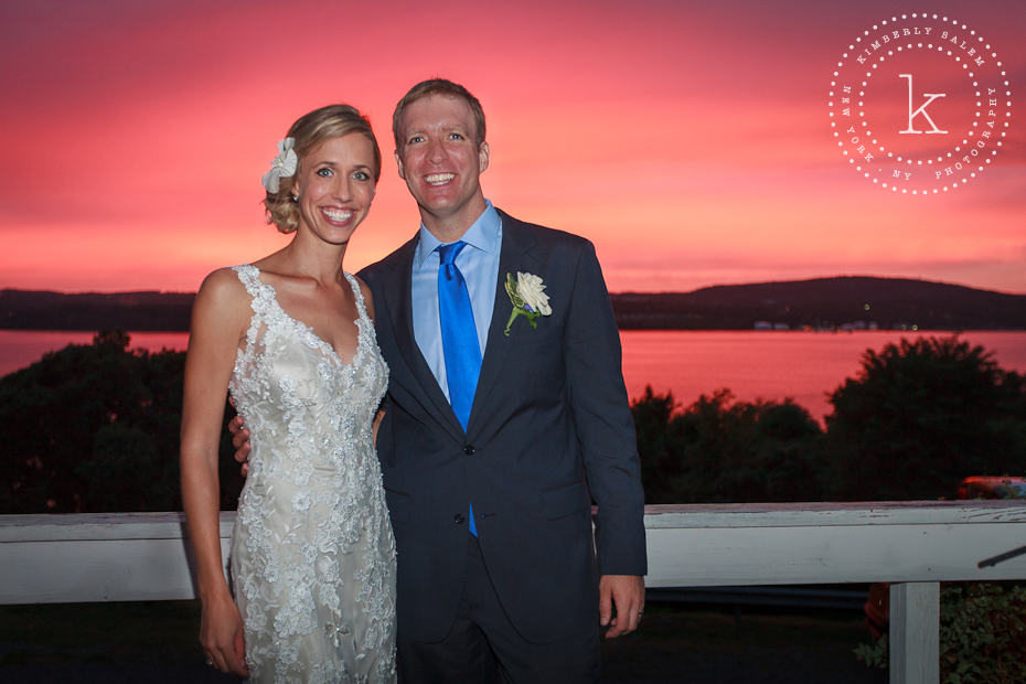 Bride and groom in front of brilliant sunset on the Hudson River
