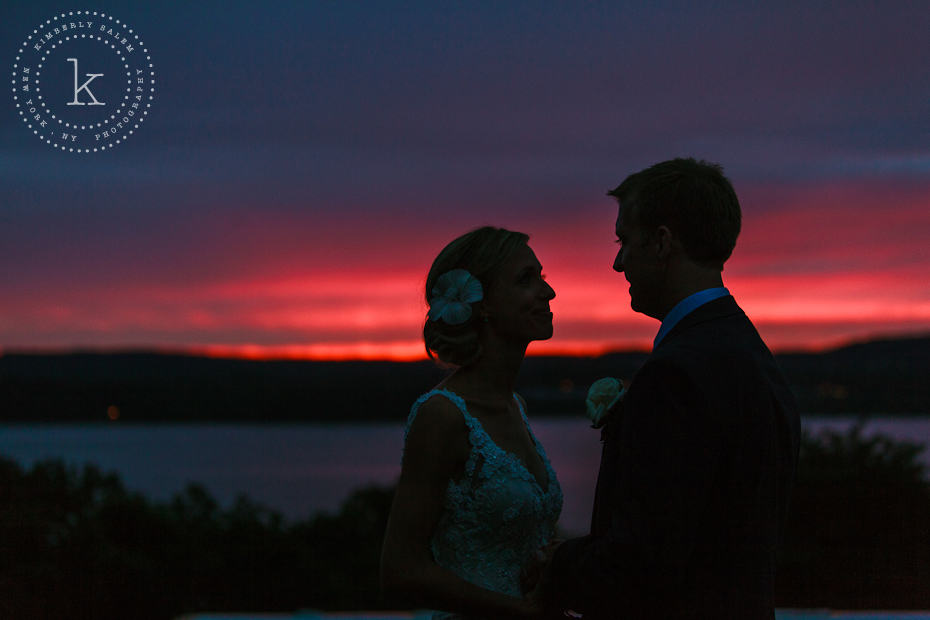 Bride and groom in front of brilliant sunset on the Hudson River - silhouette