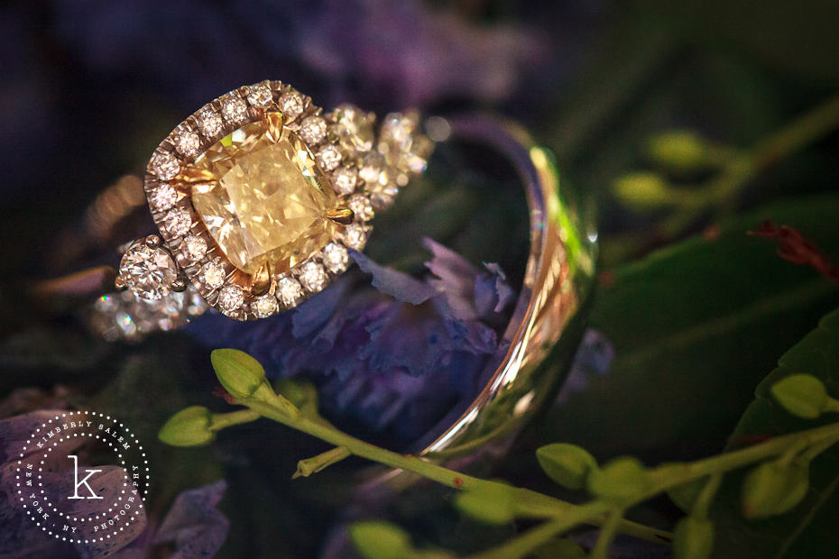 Engagement and wedding ring detail with flowers - yellow diamond