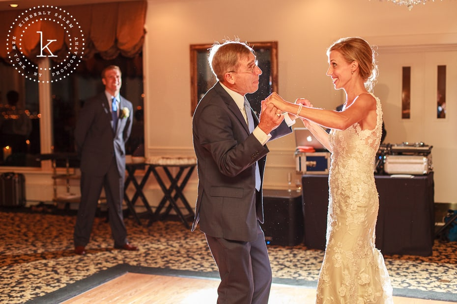 Bride dances with father as new husband looks on