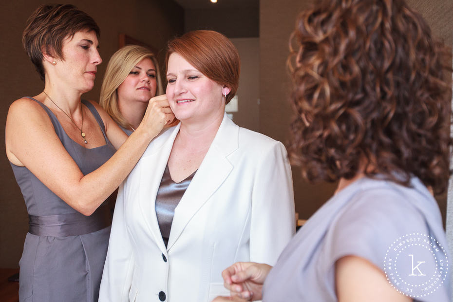 bride getting ready with bridesmaids