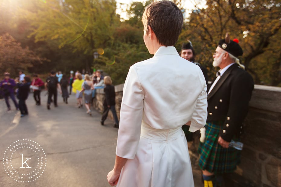 bride crossing Gapstow bridge with bagpipers on the way to the First Look