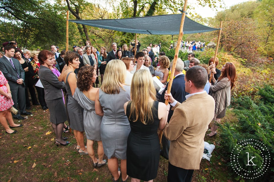 two brides married in Central Park under grey handmade chuppah