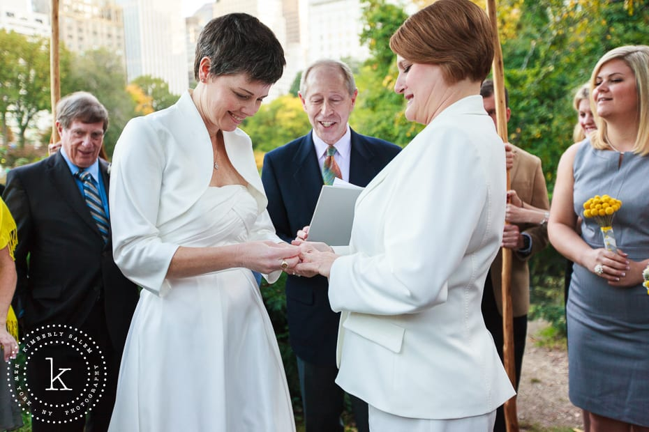 brides exchanging rings during wedding ceremony