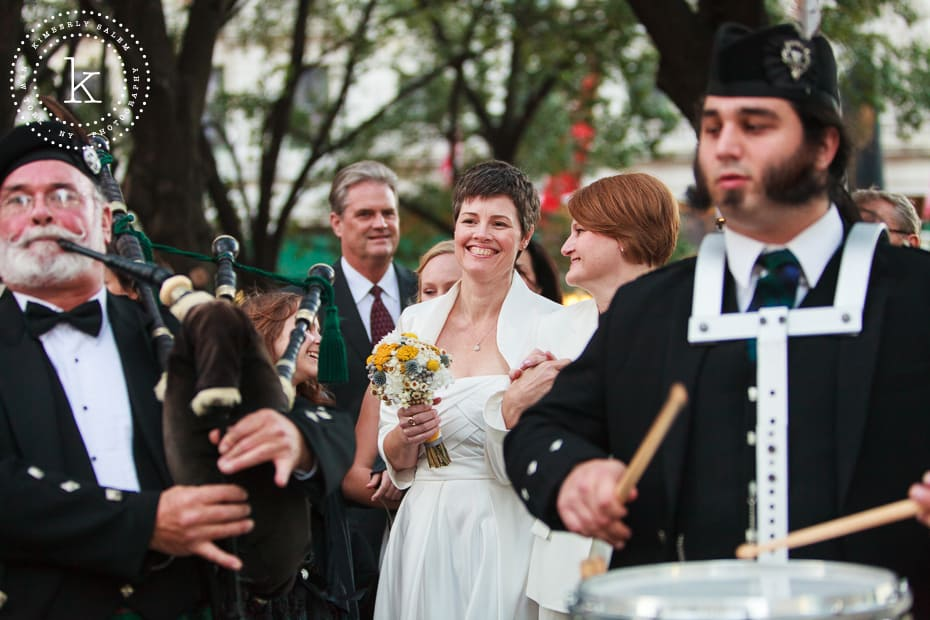 brides walk behind two bagpipers