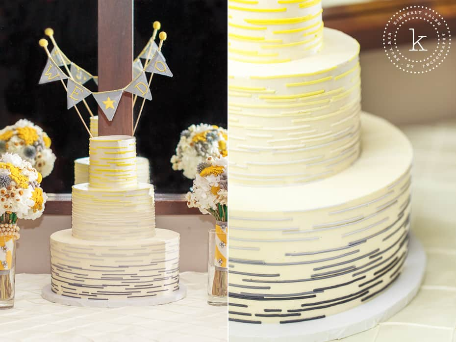 """We Do"" banner on yellow and gray modern wedding cake"