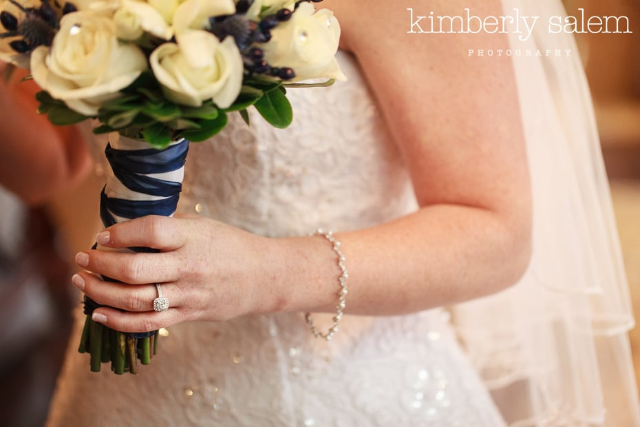 engagement ring detail with bouquet and dress