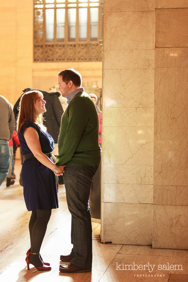 engaged couple in Grand Central station holding hands