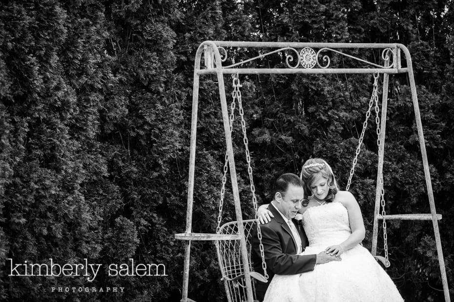 bride and groom share a moment on a swing