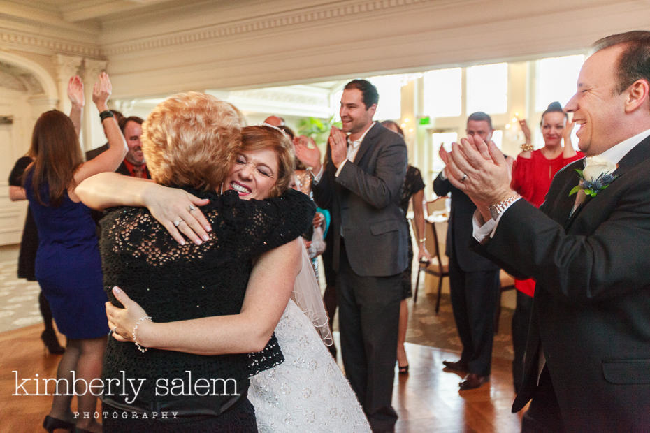 bride hugging a guest on the dance floor