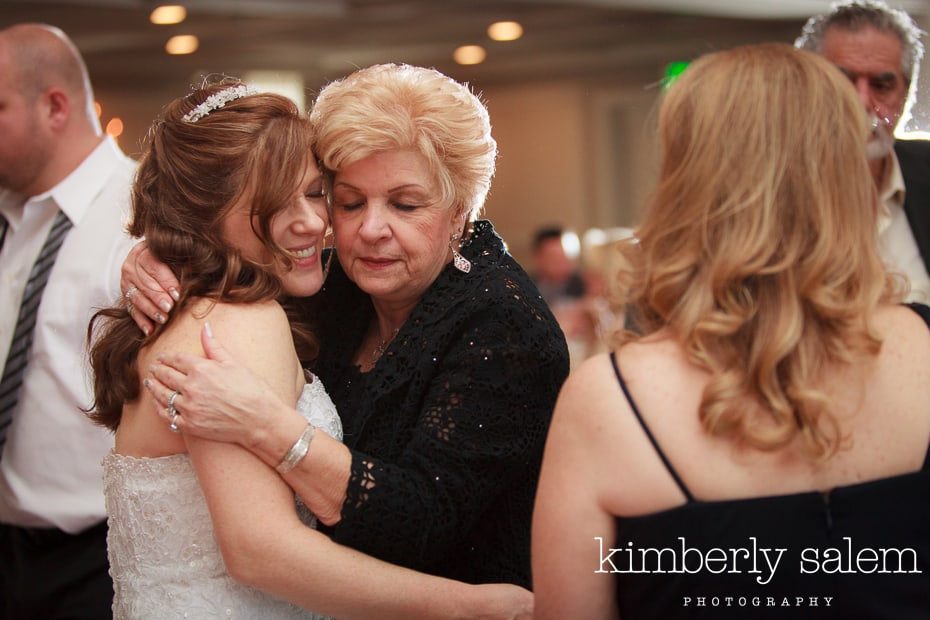 bride and her aunt hug at the wedding