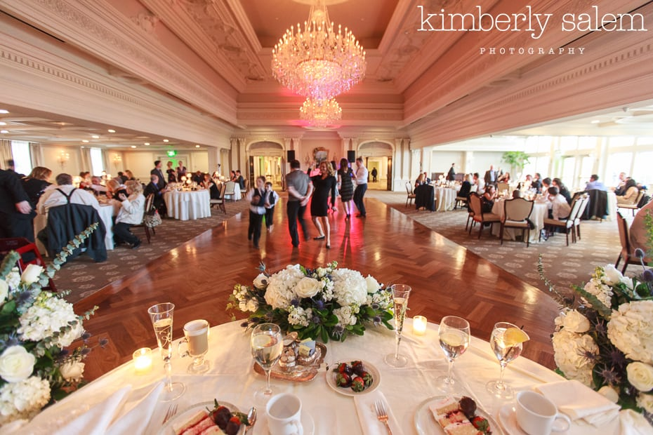 wide angle shot of wedding dance floor with flowers