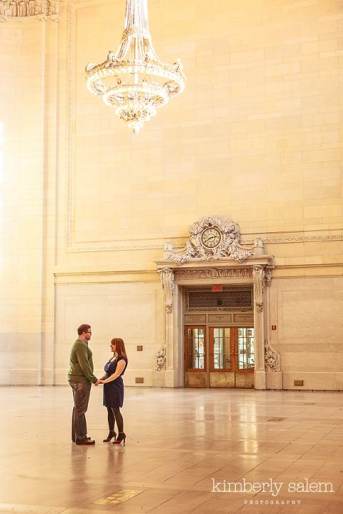 engaged couple in Grand Central station - chandelier