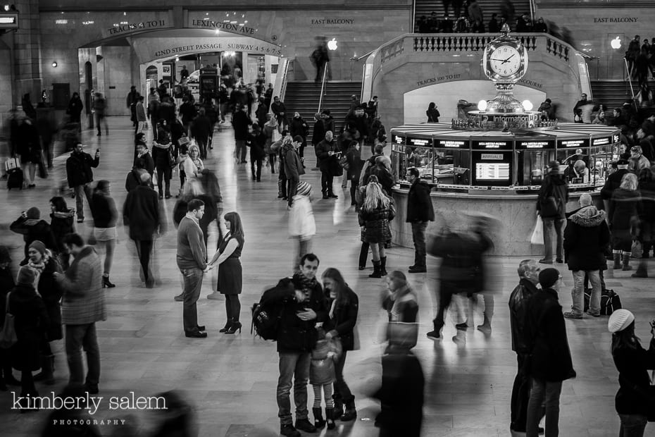 engaged couple in grand central station - motion blur around them