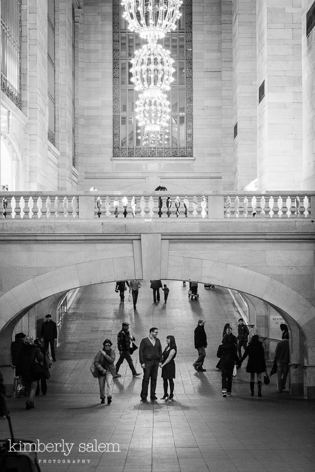engaged couple under arch in Grand Central