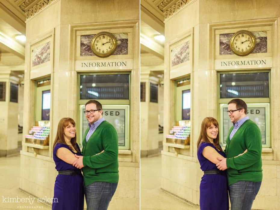 engaged couple by timetables in Grand Central