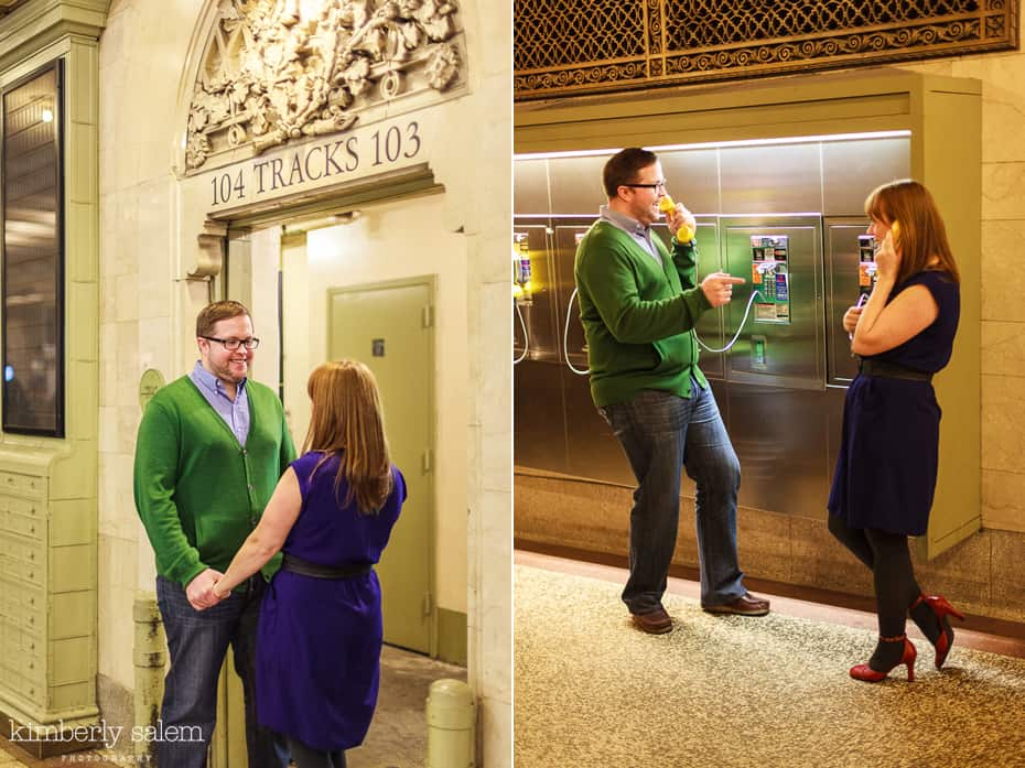 engaged couple having fun with pay phones in Grand Central