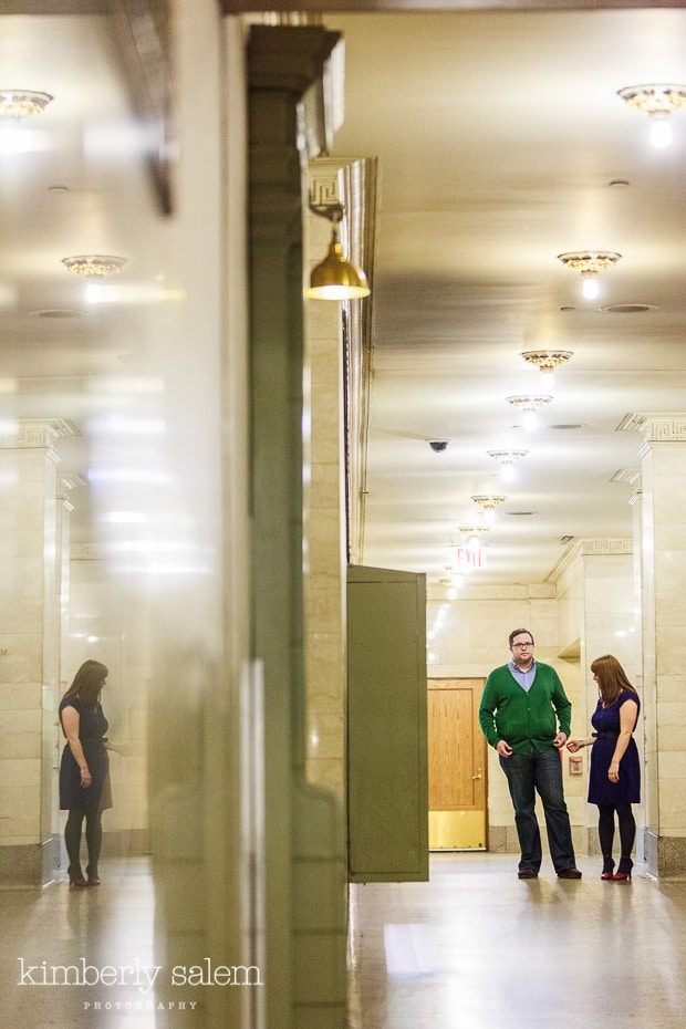 engaged couple in Grand Central in long hallway