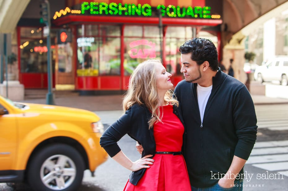 engaged couple in NYC near Grand Central - taxi cab in background