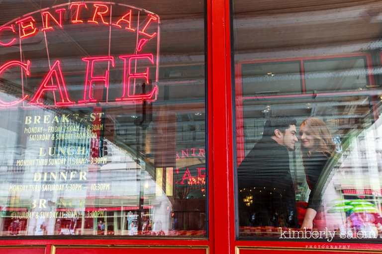 engaged couple in the window of diner near grand central in NYC
