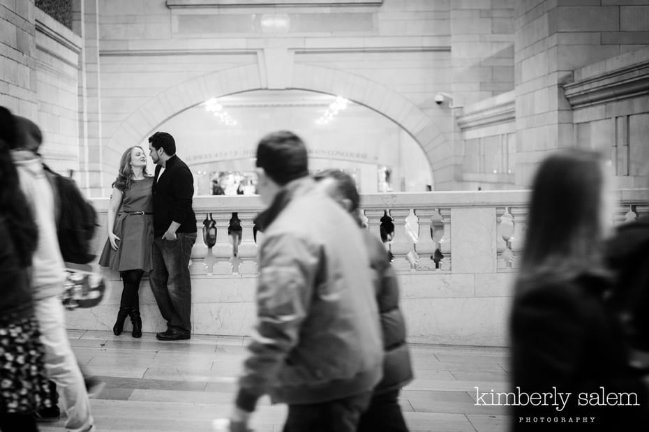 engaged couple kisses in Grand Central
