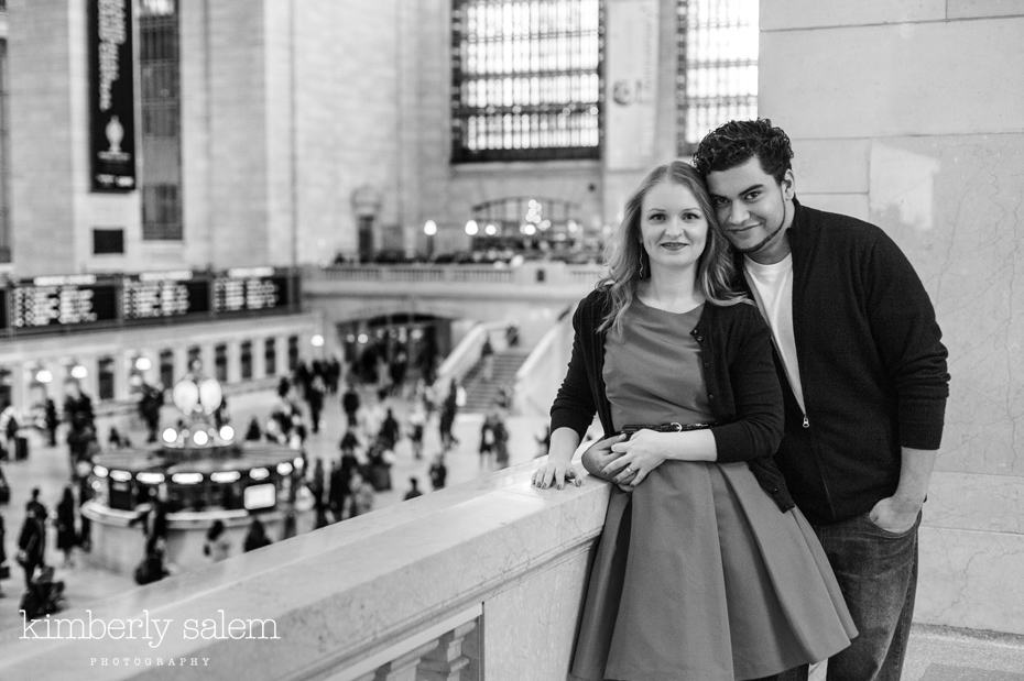 engaged couple overlooking the main floor in Grand Central