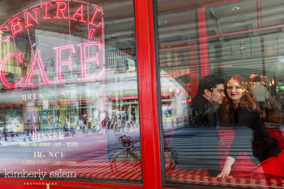 engagement photos through the window of cafe
