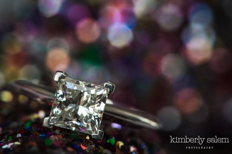 engagement ring with sparkly background