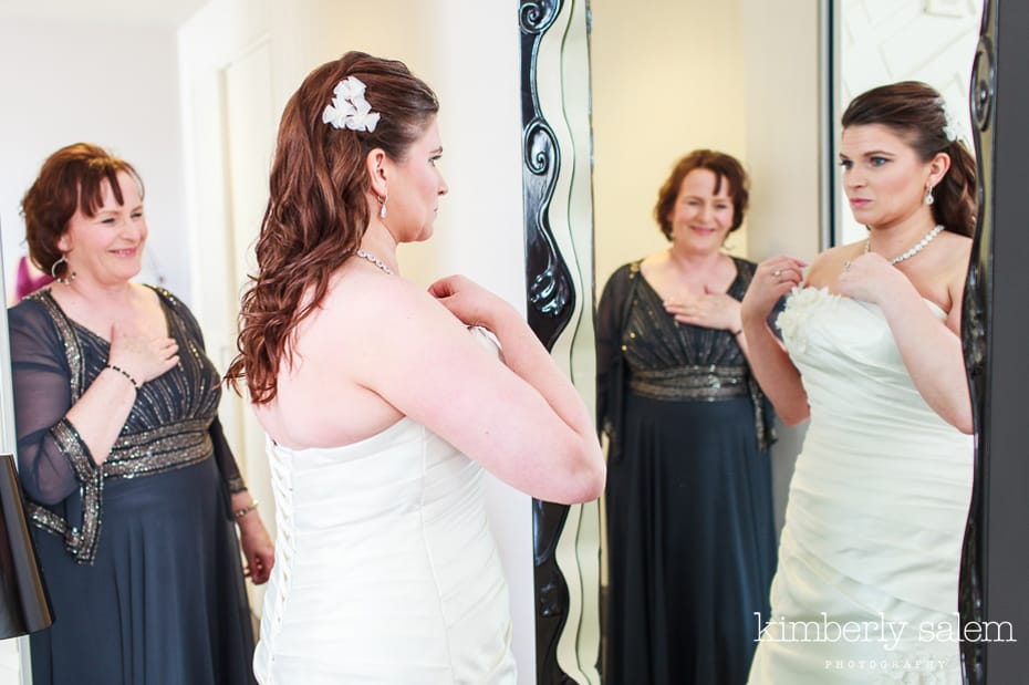 mother of bride watching her get ready